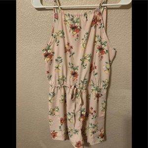 Pink romper with flowers